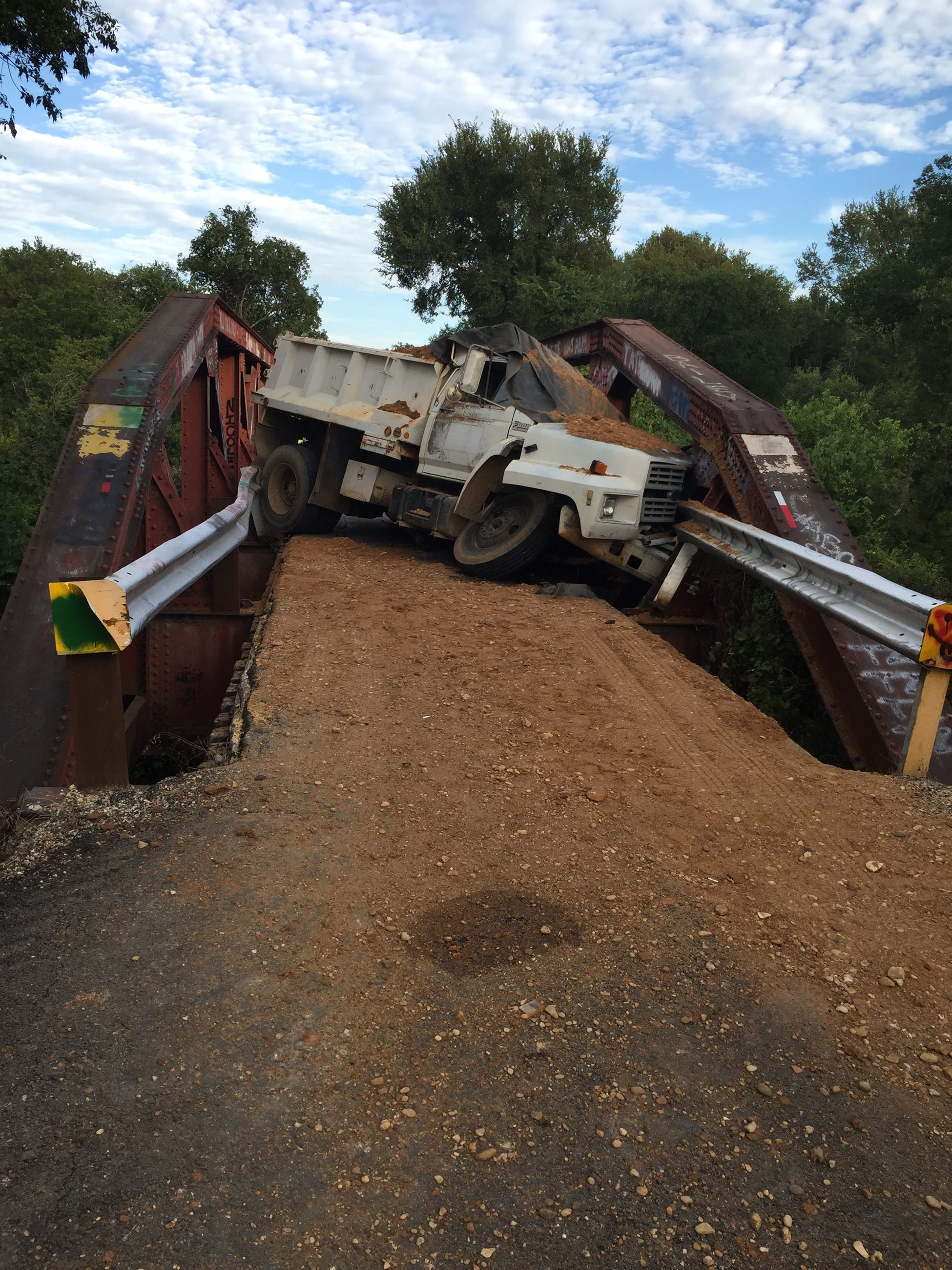 Wreck And Gravel Truck At Old Railroad Bridge