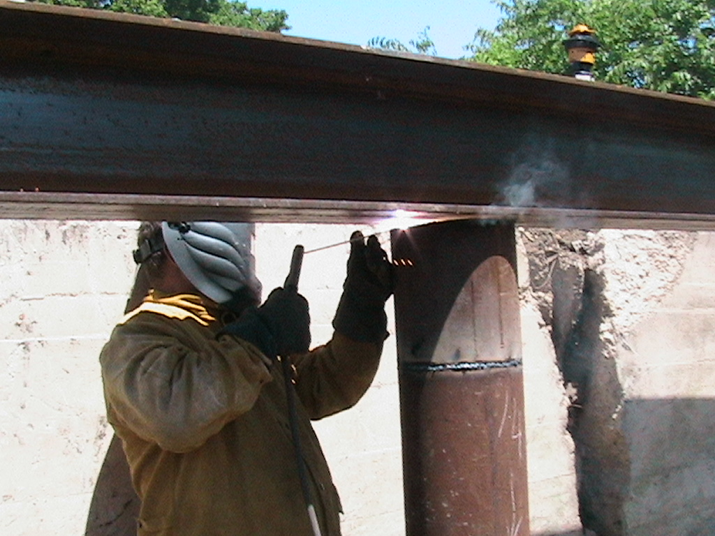 Welding the beams to the posts