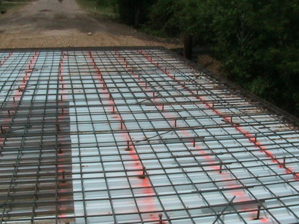 Rebar lay on top of the metal sheets